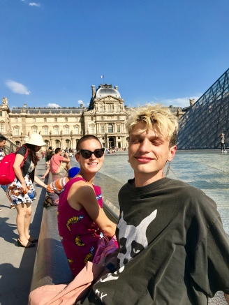 Dipping our hot and sweaty feet in the Louvre fountain